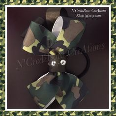 A personal favorite from my Etsy shop https://www.etsy.com/listing/508478438/camouflage-hair-bow-stacked-bow-black