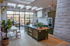 The kitchen cabinets and island are from Plain English's Osea kitchen, done up in a custom shade of olive green (see source below). Photograph byLuke Hayesfrom Kitchen of the Week: A Greatest-Hits Kitchen for a Danish-American Couple in London.