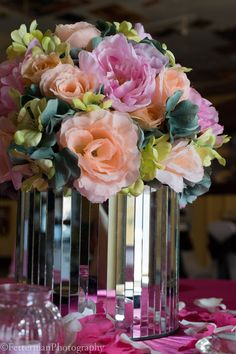 mirrored vase, roses and hydrangea, pink, peach, and teal