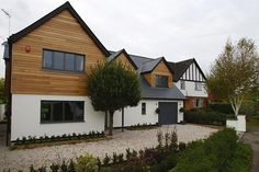 Wouldn't want the annexe to be this kind of two story, want to keep it chalet style like the other side of the house, but the colours in this house are good and like the cladding on the dormer windows. Cedar Cladding, House Cladding, Exterior Cladding, Wooden Cladding, Wall Exterior, Bungalow Exterior, Bungalow Renovation, Home Exterior Makeover, Exterior Remodel