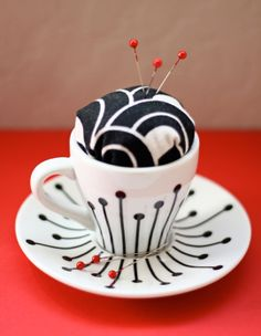 Teacup pincushion!   (Also, pinning a pincushion on Pinterest makes me smile)