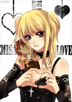 Misa Amane and a tiny Light doll! I want that doll! Misa would probably kill me if i took it though ^^;