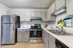 These upgraded at Apartments in are the perfect place for entertaining guests. Do you like the two toned cabinets?