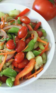 Marinated Garden Salad - A light refreshing salad made with fresh veggies that have been marinated in a balsamic dressing.