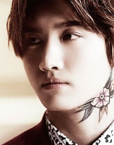 I think a real tattoo would actually suit Changmin. In my mind he's the least likely to get one though :/