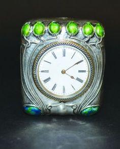 An Edwardian Silver And Enamel Strutt Clock Of Typical