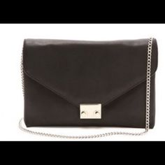 Loeffler Randall Lock Clutch Like new black lock clutch with long gold chain. Used two time! Great condition!! Loeffler Randall Bags Clutches & Wristlets