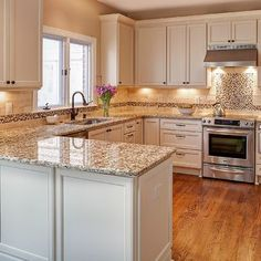 Kitchen Peninsula Design Ideas, Pictures, Remodel, and Decor - page 31 Love the color of cabinetry and counter tops, our tiles are similar
