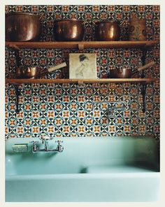 Traditional tiled backsplash, copper pots and a utility sink. Incredible combination!