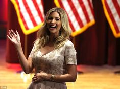 Beaming in a cream and gold dress, heavily-pregnant Ivanka waved to the crowds from the front row of her father's fundraiser for veterans in Des Moines on Thursday night