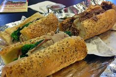 Cosmi's roast pork sandwich on the left and their cheesesteak on the right.  (Photo by J. Zale for Visit Philadelphia)