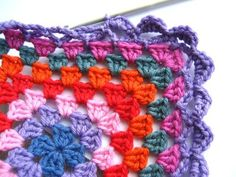 This edging is made in three rounds :: two rounds of chain loops, followed by a final round of shell/scallops, and is very easily worked around any size of granny square.