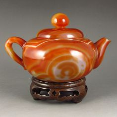 Beautiful Color Hand Carved Chinese Natural Agate Teapot Dimension: 135*95*85(mm) 5.31*3.74*3.35(in) Weight 0.76 lbs/346 g