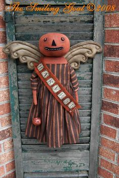 Halloween decoration on vintage window shutter.  Great for mantle, front door or porch.