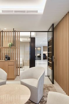 The interiors of these high-end office strike a perfect balance between a corporate space for business and an inviting atmosphere for social purposes. African Interior Design, Citizenship, Office Interiors, Dubai, Investing, Office Designs, Furniture, Space, Business