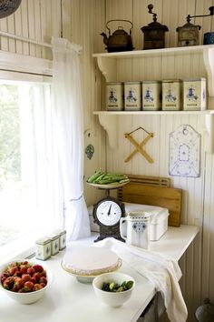 farmhouse kitchen, dinner's going to be good! This all white is OK, it has some contrast to balance it. I do love bead board! It always looks fresh.