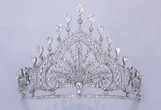 A belle epoque tiara, 1910, with some serious height to it. It's designed as a foliate spray of diamonds as it's central panel, surrounded by a frame of smaller diamonds, and topped by a series of inverted pear-shaped diamonds. The property of a Lady it was sold by Christie's on 21st November 2002 for CHF 19,500