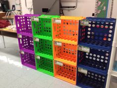 Quick and easy storage using colorful crates and zip ties.  I'm using this storage unit as backpack storage for my pre - K class.