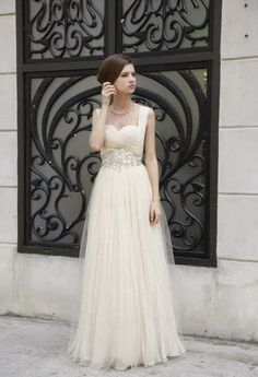 Emily, this is freaking gorgeous. Some lady makes it on Etsy and its like 500 dollars. I think this kind of a dress would be so pretty on you.