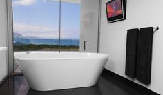 This magnificent bathroom makes use of a floor to ceiling window, capitalising on the outstanding coastal backdrop. The Kaldewei Vaio Duo Freestanding Bath takes centre stage, perfect for unwinding and enjoying the view.