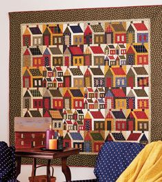 To get the scrappy look of this quilt in a speedy way, invite your friends  over for a house-block quilting party.