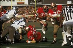 Running back Vic Washington of the San Francisco 49ers runs upfield against the Dallas Cowboys in the 1972 NFC Championship Game at Candlestick Park.