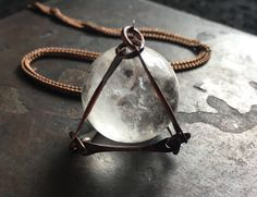 A stunning 18-22mm quartz crystal encased in copper. Each copper piece was hand-cut, hammered, filed and then assembled by me :) Slips easily over the head. 32 vintage copper chain Handmade in NY ** listing is for (1) necklace ** each crystal will vary but will be equally beautiful
