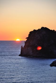 Ermones, Ermones, Greece - Sunset view from ermones.This place has one of the best sunsets in Corfu as it is located that way that the sun sets just in front of you in july and august. Like my fb page: stories from greece to see my tips as a local!