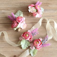 Could use the wrist corsages for napkin rings - Features purple peony buds, lavender, succulents and flat dusty miller - Available as a lapel boutonniere or a wrist corsage - Boutonniere includes twine string wrap - Slide pin on the back of bouto Boutonnieres, Corsage And Boutonniere Set, Prom Flowers, Bridal Flowers, Silk Flowers, Flower Corsage, Wrist Corsage, Bracelet Corsage, Handmade Rakhi Designs