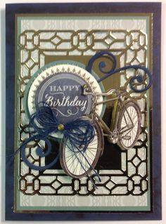 Mix and match Anna Griffin papers and embellishments.