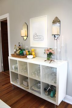 Live Creating Yourself - dining rooms - Behr - Dolphin Fin - West Elm Sconce, Ikea Expedit Bookcase, Ikea, Expedit, white, bar, buffet, West Elm, mirrored, sconces, Ikea, Blomster, candlesticks, gray walls, paint color, dining room, gray walls, gray paint, gray paint colors,