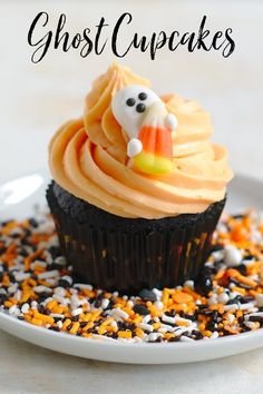 Ghost Cupcakes - A delicious black chocolate cupcake topped with orange vanilla buttercream frosting and a cute candy ghost! Perfect for a Halloween party! Halloween Recipes | Halloween Cupcakes | Halloween Dessert
