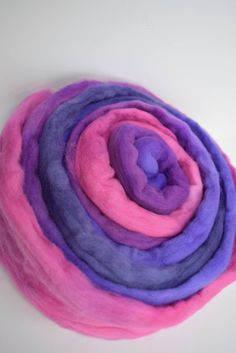 100% Australian grown Merino wool roving/tops 100 grams 19.5 micron You will receive 100 grams of this colour way.  Australian merino wool tops have a lovely soft squishy fibre and are excellent for art yarn, spinning, carding, nuno felting, needle felting and wet felting as well as many other fiber art, textile and craft uses. It is also suited to drop spindle spinning.  My wool is dyed with commercial colour fast dyes but please be aware that colours may vary on computers. These beauti...
