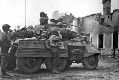 An American M8 scout car from the 3rd Armoured Division.