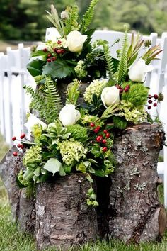 Tree trunks with lush greens - mix in branches for height (no roses)