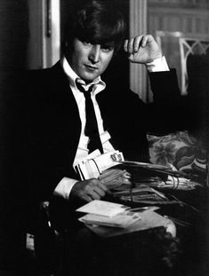 John Lennon reading fan mail, circa 1964
