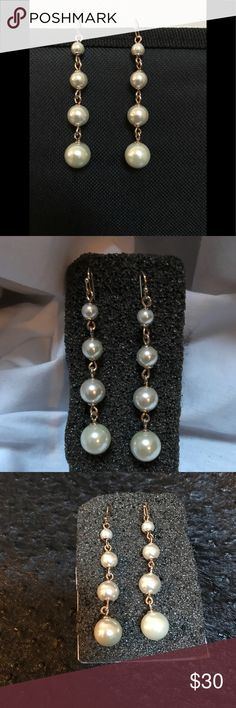 """Neiman Marcus NWOT pearl earrings Neiman Marcus 4 pearl drop/dangle  earrings with wire back. 3.5"""" long. The pearl colour is natural and the metal is gold fill. Neiman Marcus Jewelry Earrings"""