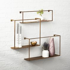 Shop Antiqued Brass Floating Shelves Set of 3. Industrial chic set composes a geometric gallery. Three different dimensions architect an arrangement of your design: Scatter open and airy across the wall or overlap as concentrated grid of right angles.