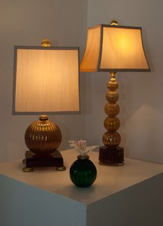 Here is the Paris to the left, the Madeleine to the right and pedaled vase in one of the newer deep emerald greens currently at Gallery 3954. www.fifiblaughlin.com, www.gallery3954.com  #vase #flowers #designer #decor #lamps #lighting