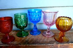 vintage drinking glasses... for drinks or candles, or jewels, gems. would fit right in a well lit room