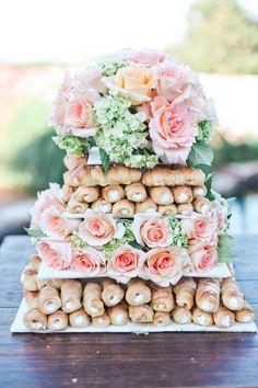 Fancy doughnut wedding cake with flowers.