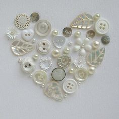 c Cute idea. Use old buttons to create a heart shape like this, top it off with a shadow box frame to finish the look, and you have homemade art! This would be cute in a star with colored buttons. Diy Buttons, Vintage Buttons, Buttons Ideas, Button Art, Button Crafts, Heart Button, Arts And Crafts, Paper Crafts, Diy Crafts