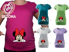 A trendy woman's T-shirt with very short sleeves and flex print, loose cut, with the bottom edge sewn into a wide hem. A round neck with a narrow hem of