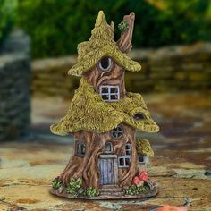 Fairy Homes and Gardens - Solar Thatch Roof Fairy Tree House, $42.99 (https://www.fairyhomesandgardens.com/solar-thatch-roof-fairy-tree-house/)