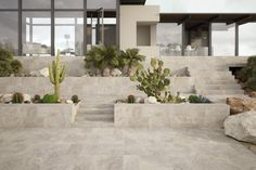 Sassuolo Stone Universe Exterior Porcelain Tile.. Even the Planters and Treads are Porcelain Tile. WOW!!!!