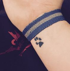 61 Impossibly Tiny And Tasteful Tattoos: in memory of her cat. I should have one for Belle.