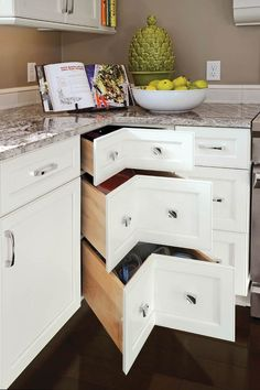 These convenient corner drawers are just one of the new designs in wall cabinets.