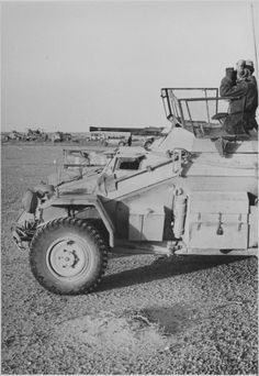 A Afrika Corps Sd.Kfz.222 light armored reconisance vehicle on the front lines in Libya.