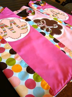 custom capes for little giRLs - monograms made of fabric on top of felt decorative embroidery stitch and a few gems for charm. (no instructions just images)