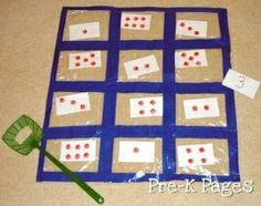 Super cute number recognition game! Ziplock bags taped together, add a fly swatter and swat the number! by celia